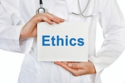 Picture of a doctor holding a sign that says ethics.